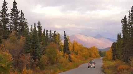Wall Mural - SUV Travels Remote Alaska Road Fall Winter Approaching