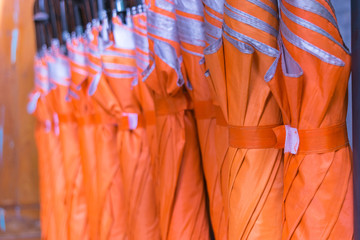 Many orange umbrellas are available