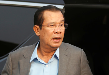 Cambodia's Prime Minister Hun Sen arrives for the inauguration ceremony of National Road No. 1, which has been built with aid from Japan, in Phnom Penh, Cambodia