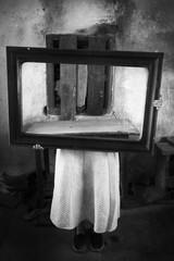 Horror girl in creepy old interior holding mirror