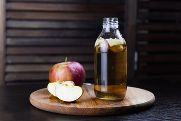 kombucha with apple wooden background