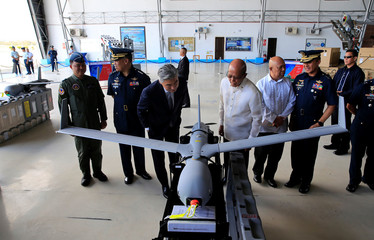 Philippine Defence Secretary Delfin Lorenzana and U.S. Ambassador to the Philippines Sung Y Kim inspects the ScanEagle Unmanned Aerial Vehicles during a transfer from the U.S. to the Philippine Air Force at the Villamor Air Base in Pasay city