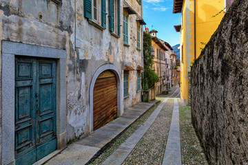 Narrow cobbled street in small italian town.