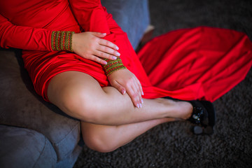 Attractive female legs, girl in red dress