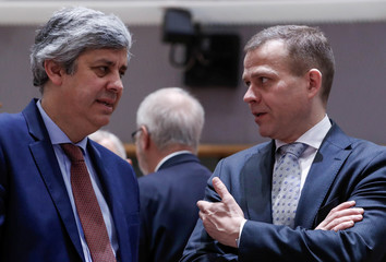 Portugal's Finance Minister and Eurogroup President  Centeno and Slovakia's Finance Minister Kazimir attend the European Union finance ministers meeting in Brussels