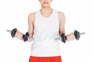 Wall Mural - Cropped image of young skinny man holding dumbbells isolated on white