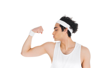 Wall Mural - Side view of young thin sportsman showing muscles on hand isolated on white