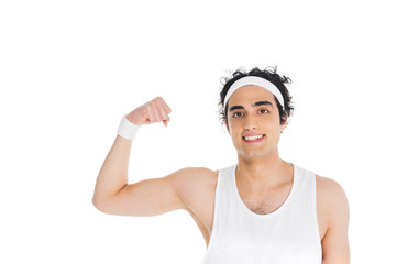 Wall Mural - Portrait of thin sportsman in headband showing muscles on hand isolated on white
