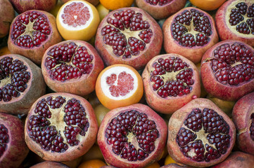 Sliced Pomegranates And Oranges