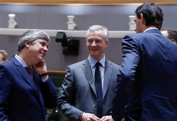 Portugal's Finance Minister Centeno, France's Finance Minister Le Maire and Dutch Finance Minister Hoekstra attend the European Union finance ministers meeting in Brussels