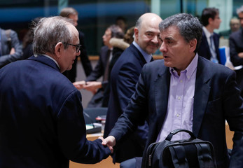 Italy's Economy Minister Padoan and Greece's Finance Minister Tsakalotos attends a EU finance ministers meeting in Brussels