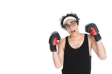 Wall Mural - Young thin boxer in eyeglasses standing isolated on white