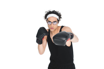 Wall Mural - Young thin boxer in eyeglasses beating by hand isolated on white