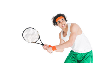 Wall Mural - Thin tennis player exercising with racket isolated on white