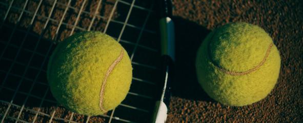 Tennis balls on racket, sport equipment