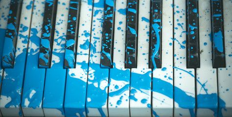 Painted piano, musical style, grunge instrument.