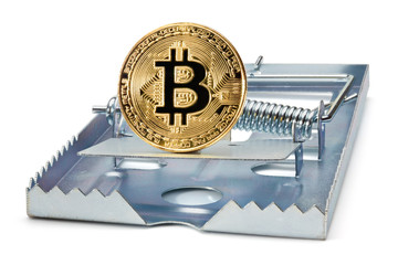Mousetrap with gold bitcoin.