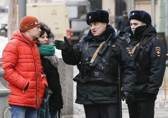 A policeman shows the way to pedestrians in central Moscow