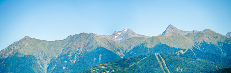 Panoramic photo of mountainous area with green vegetation
