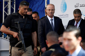Palestinian Prime Minister Rami Hamdallah arrives at the inauguration ceremony of a waste treatment plant after an explosion targeted his convoy, in the northern Gaza Strip