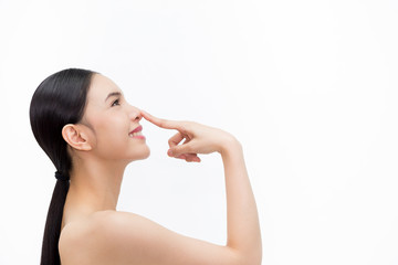 Young attractive woman touching her nose with fingertip over isolated white background.