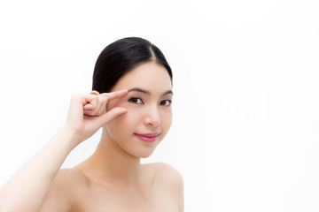 Young attractive woman in natural beauty condition gently touching eyes to focus on eyecare health isolated over white background.