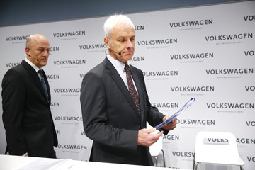 Volkswagen CEO Mueller and CFO Witter leave the annual earnings news conference of VW in Berlin in Berlin