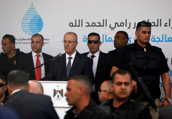 Palestinian Prime Minister Rami Hamdallah speaks during the inauguration ceremony of a waste treatment plant after an explosion targeted his convoy, in the northern Gaza Strip
