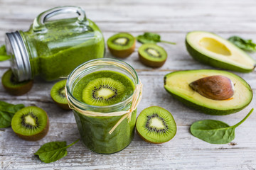 A delicious and healthy green smoothie in jar.