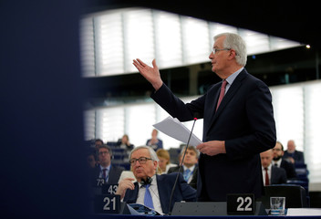 European Commission President Juncker listens to European Union's Chief Brexit negotiator Barnier as he addresses the European Parliament during a debate on the guidelines on the framework of future EU-UK relations in Strasbourg