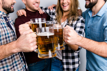 Network socializing bonding connection triumph holiday concept. Cropped close up photo of excited delightful cheerful guys clinking pints of beer, casual checkered outfit, fan of championship football