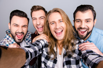 Diversity virility masculinity spend funtime concept. Close up photo of four excited enthusiastic astonished amazed friendly guys taking selfie checkered jeans shirt isolated on gray background