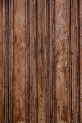 Brown wooden texture. Old planks with peeling paint.