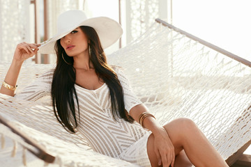 Fashion Girl In Elegant White  Hat And Fashionable Clothes
