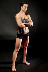 Muscular bodybuilder woman showing her muscles.