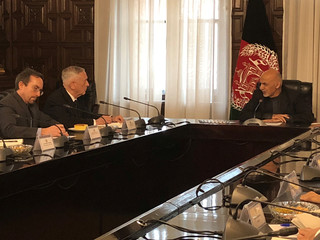 Afghan President Ashraf Ghani speaks with U.S. Defense Secretary Jim Mattis in Kabul
