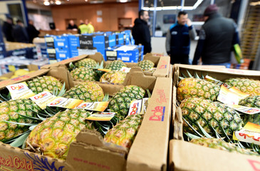Pineapples are offered at the wholesale fruits and vegetables market in Hamburg
