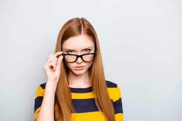 Boss employment university campus knowledge concept. Close up portrait of confident serious concentrated focused astonished shocked teenager touching glasses isolated on gray background copy-space