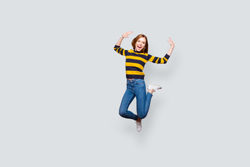 Lifestyle leisure astonished shock unbelievable incredible careless holidays concept. Full-length full-size portrait of cute cheerful wondered pretty mad manager jumping up isolated gray background