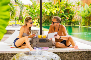 Couple relaxing in luxury villa by the pool