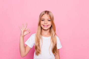 Elementary dream dreamy perfect excellent studying learning concept. Portrait of cute lovely beautiful adorable sweet with beaming smile in white tshirt girl making ok symbol isolated pink background