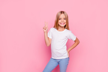 Fun joy enjoy people person funtime concept. Portrait of cute lovely carefree confident sweet adorable beautiful girl in casual modern outfit demonstrating v-sign isolated on pink background Wall mural