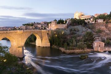 Evening view of Toledo old town, de Alcantara bridge and Tagus river
