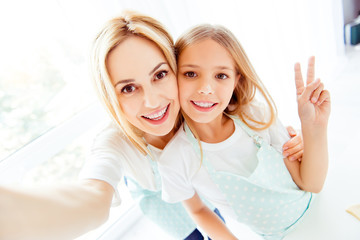 Taking making photo memory internet peace support trust care helper blonde hair concept. Close up portrait of excited cheerful cute lovely sweet adorable pretty mom kid looking in camera