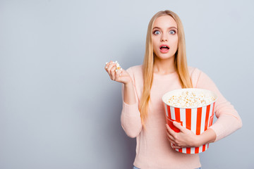 Style stylish trendy person people reaction impressed disbelief concept. Portrait of lovely cute pretty girl watching film int he cinema eating popcorn isolated on gray background copyspace