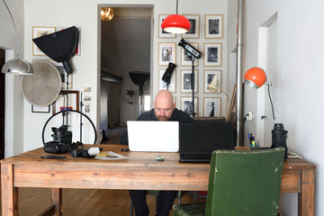 photographer working in his photography studio