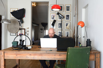 portrait of a photographer in his photography studio working