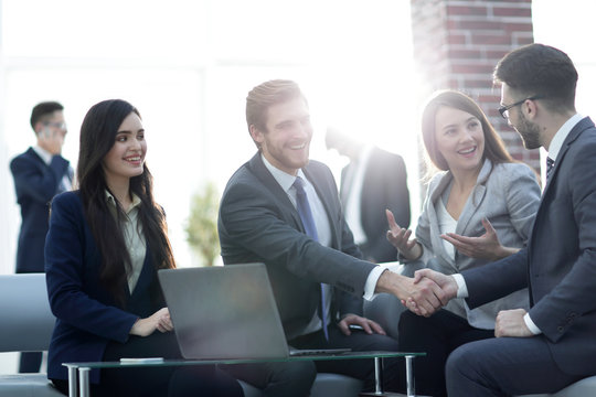 Successful partnership in business displayed by shaking hands in