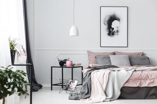 Poster in pink bedroom interior