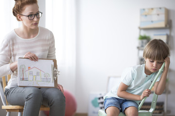 Psychotherapist showing picture to boy